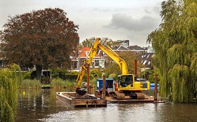 Dredging an inland canal by crane