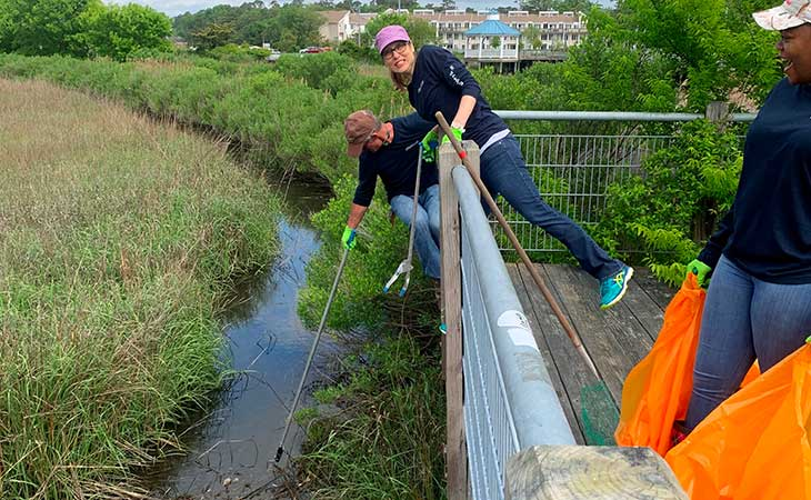 Financial Services Director Chandra Snyder and Husband Martin Removing Trash From Little Neck Creek