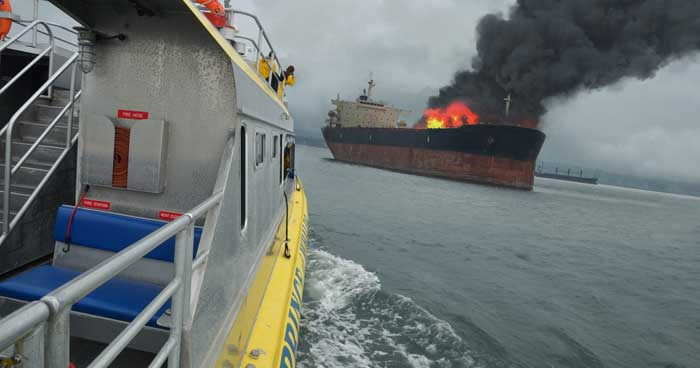 burning commercial ship